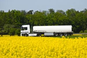 Truck against a field of rape from the biodiesel © Shutterstock